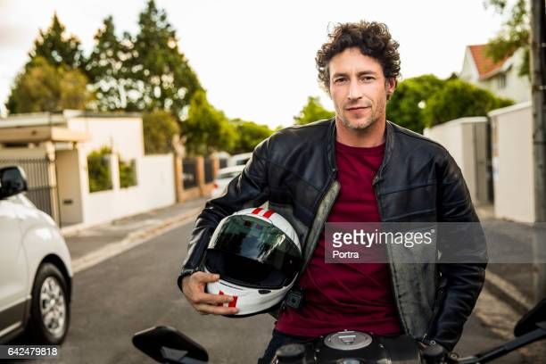 Confident man sitting on motorcycle