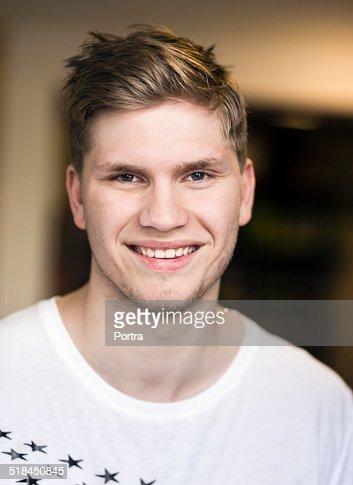Confident man smiling