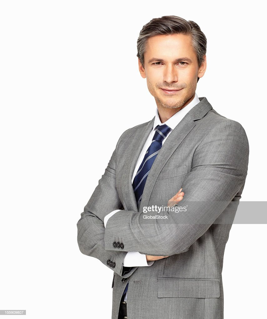 Confident mature businessman with his arms folded