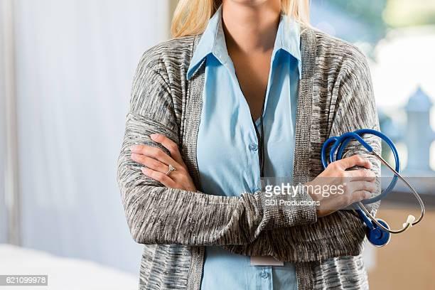 Confident medical professional in exam room