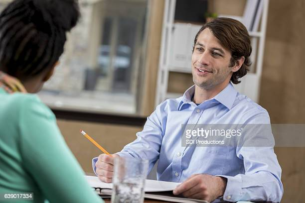 Confident mid adult Caucasian businessman meets with female client