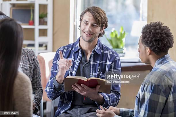 Confident mid adult Caucasian man participates in Bible study