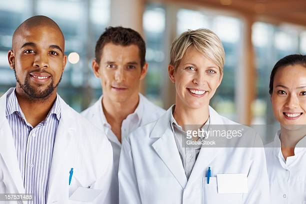 Confident multi racial doctors smiling