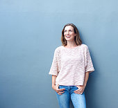 Portrait of a confident relaxed trendy middle aged woman smiling