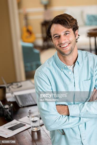 Confident self employed man in home office