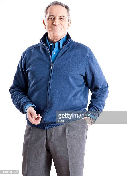 Confident senior man wearing blue cardigan