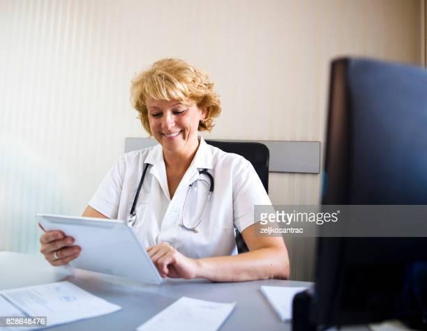 Confident senior medical professional