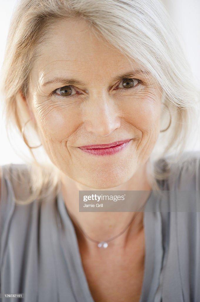 Confident senior woman, smiling : Stock Photo