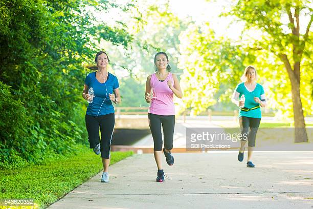 Confident senior women jog in the park