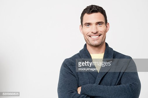 Confident smiling casual guy : Stock Photo