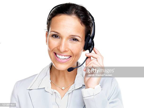 Confident smiling female agent with black headset