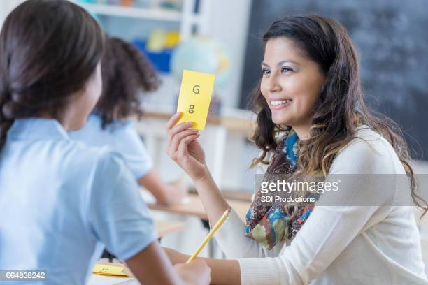 Confident teacher works with student
