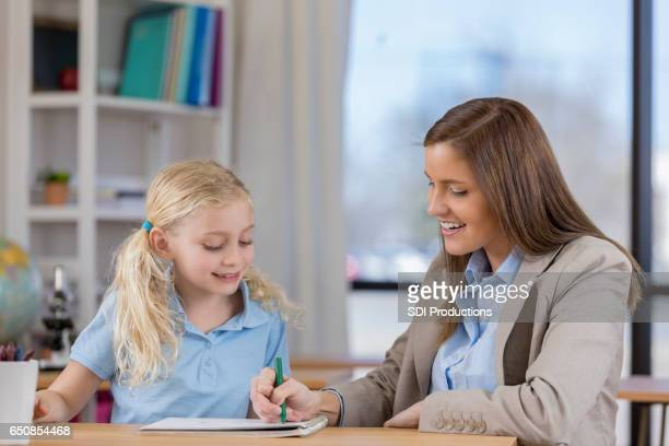 Confident teacher works with young student