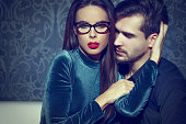 Smart confident woman entice young rich man, playing with feelings