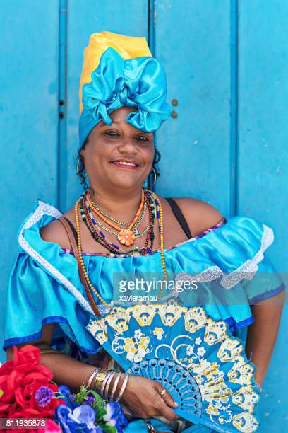 Confident woman in blue Cuban traditional costume