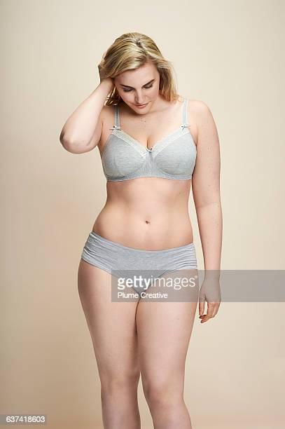 Confident woman in underwear