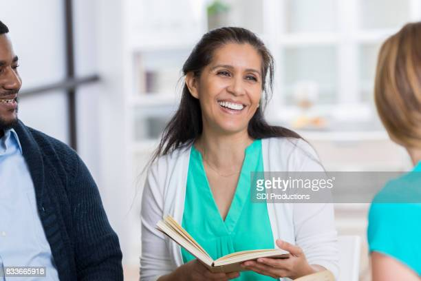 Confident woman leads study group