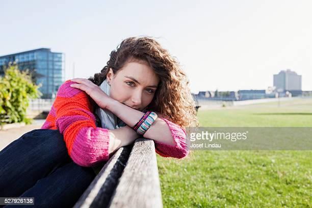 Confident woman sitting on a bench