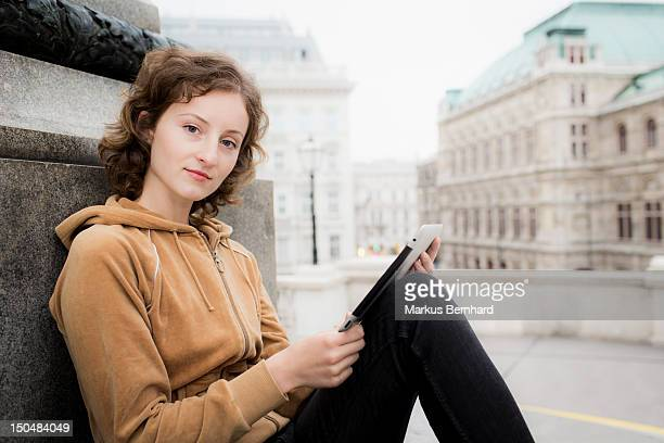 Confident woman using tablet computer