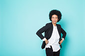 Confident woman with afro, white shirt and jacket