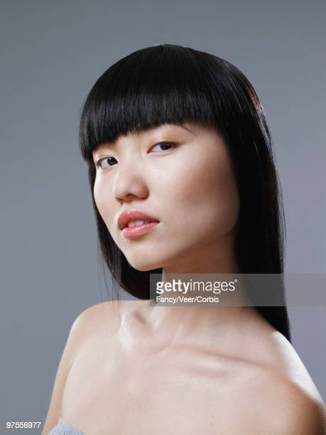 Confident woman with long black hair