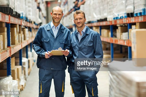 Confident workers standing in warehouse