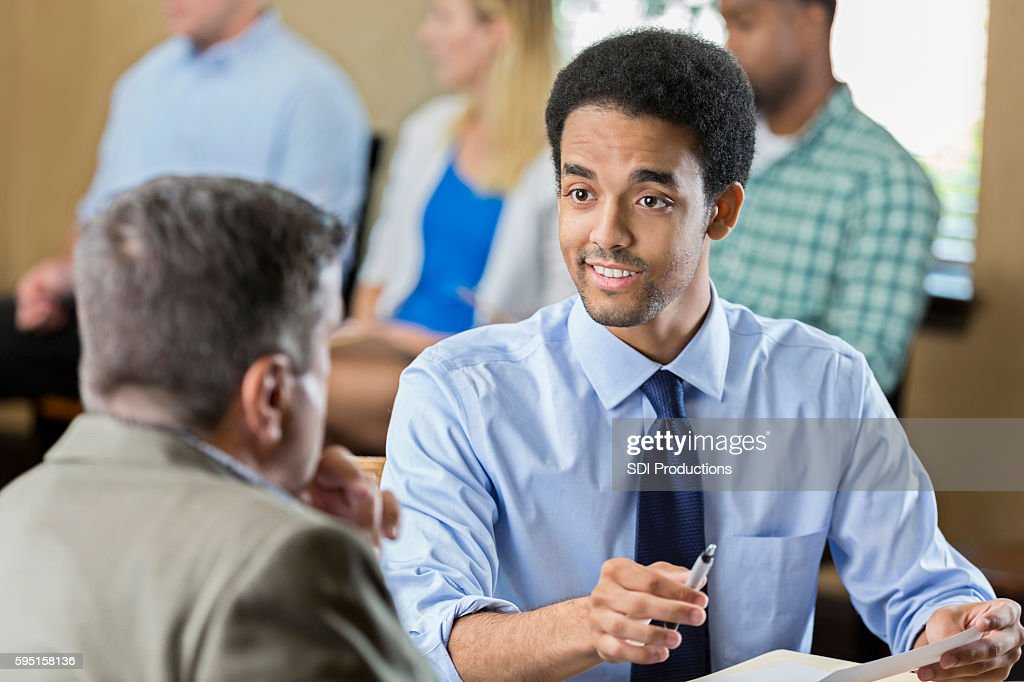 Confident young adult male at a job interview