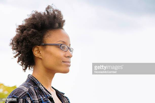 Confident young black female student profile looking away