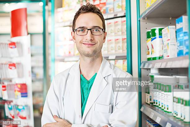 Confident young male druggist