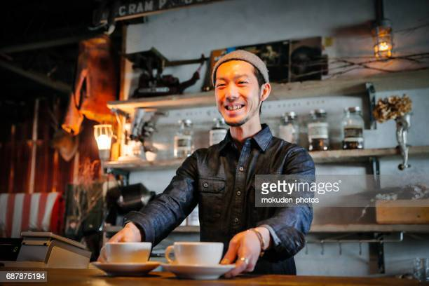 confident young male happy cafe owner