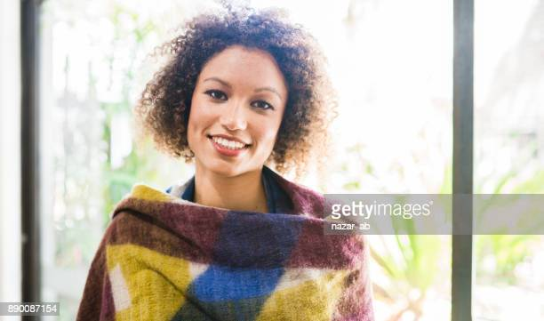 Confident young mixed race woman with a smile.