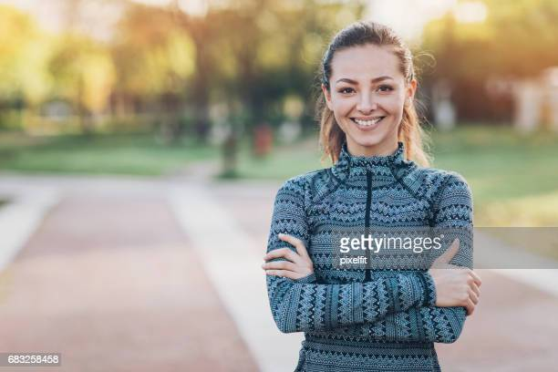 Confident young sports woman