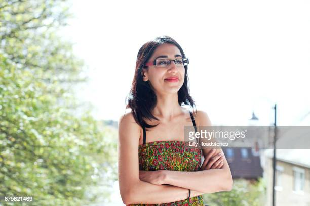 Confident young woman wearing glasses