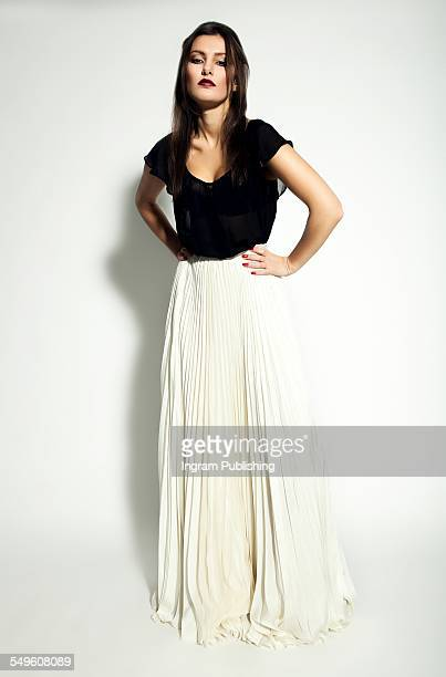 Confident young woman with maxi skirt