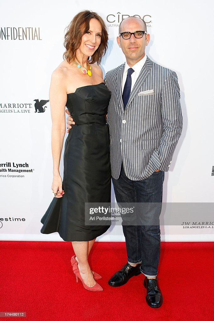 LA Confidential Publisher Alison Miller and Avi Brosh arrives at Los Angeles Confidential Magazine Celebrates With Cover Star Sean Combs Summer Issue Party Honors LA's Business Titans at JW Marriott Los Angeles at L.A. LIVE on July 25, 2013 in Los Angeles, California.