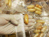 Confiscated capsules containing about 15 grams of cocaine each are displayed at the Brussels Federal Police station on April 24 2007 in the Belgian...
