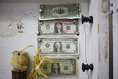 Confiscated currency and a booby trap are displayed inside the Kentucky State Police Cannabis Suppression Branch at the LondonCorbin Airport in...