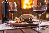 Confit rabbit leg with vegetable bread redvine in pub or restaurant.
