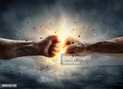 Conflict Concept - Two Fists In Impact : Stock Photo