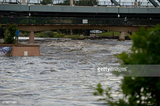 Confluence Park was under water from the rushing river as people stopped to take a look at the raging waters after a rain storm blew threw June 24...