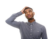 Close up portrait of a confused african american man isolated on white background