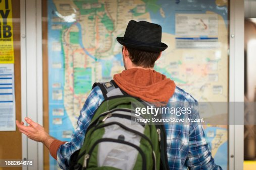 Confused man reading city map : Stock Photo