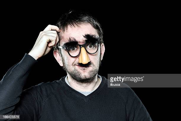 Confused man with fake nose, glasses, moustache and eyebrows