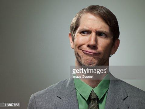 Confused mid adult businessman, portrait