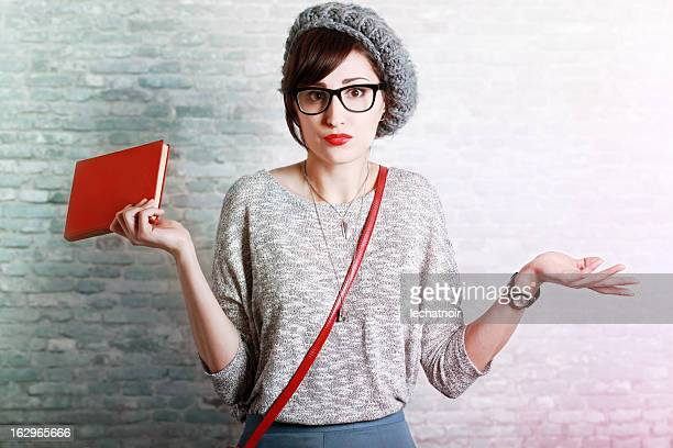 Confused student holding a book