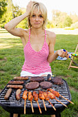 Confused woman grilling meat