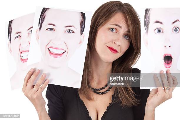 Confused Woman Holding Photographs of Her Emotions