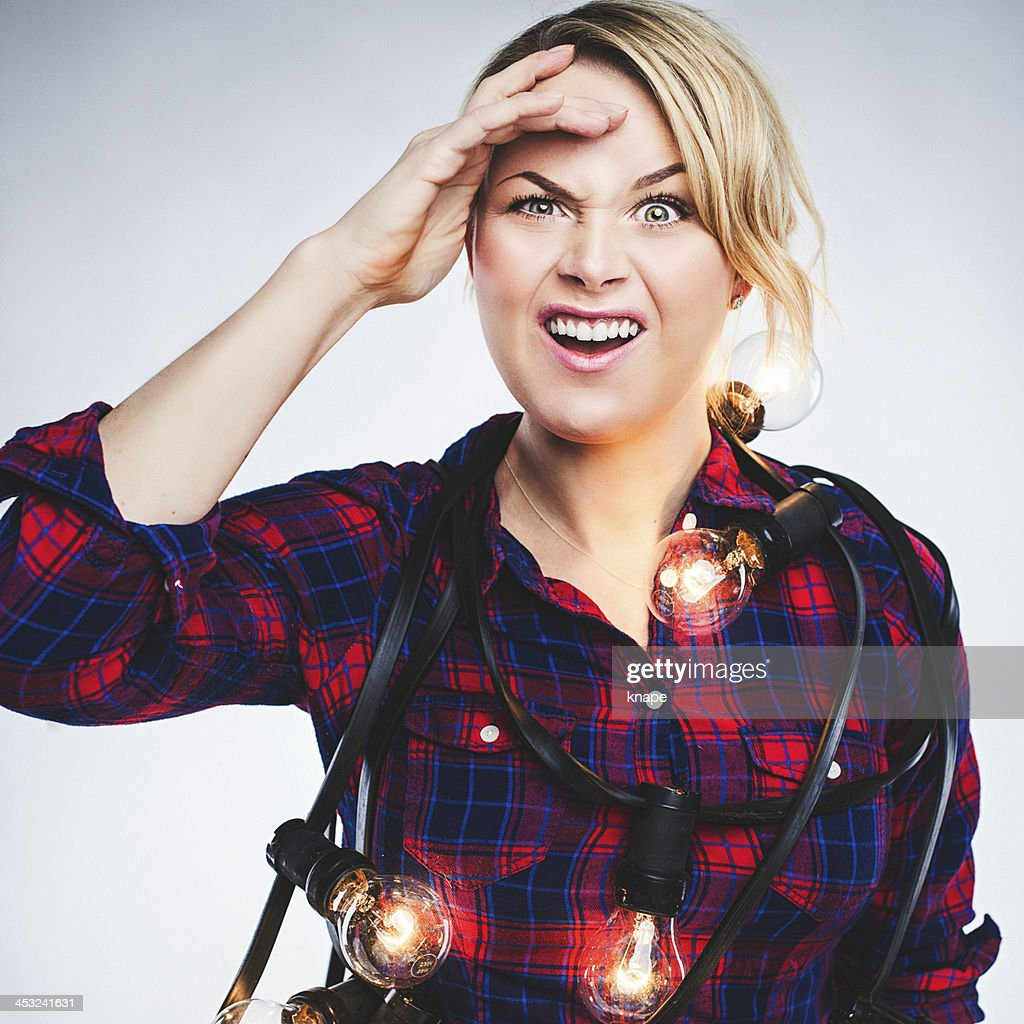 Confused woman with christmas light