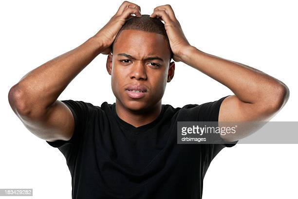 Confused Young Man Scratches Head