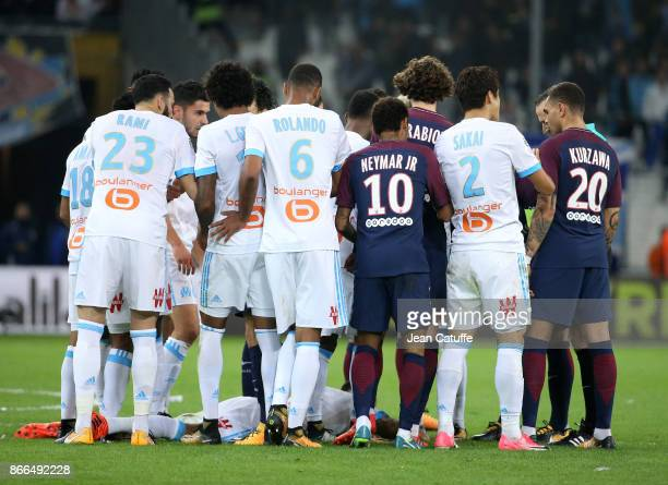 Confusion between players of OM and PSG when Lucas Ocampos of OM lies down pretending being hit by Neymar Jr of PSG during the French Ligue 1 match...